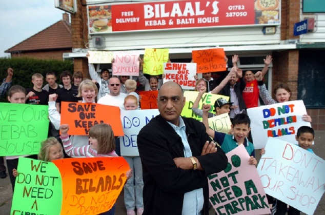 Sajid Munir, owner of Bilaal's fast food takeaway, with protesters.