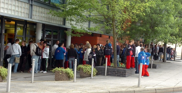 The queue of contestants for the first year of the Stoke's Top Talent variety contest outside the Victoria Hall in Hanley.