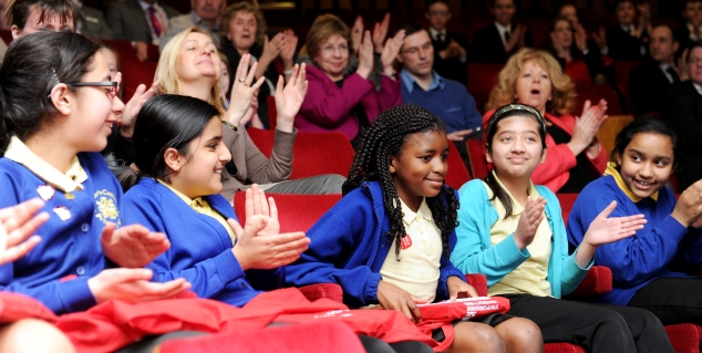 Youngsters celebrate as one of their classmates wins a Young Journalist Award.