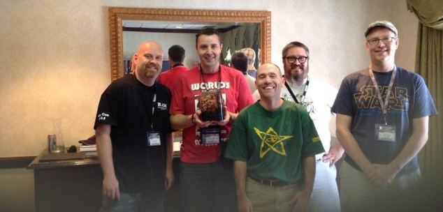Yours truly being presented with the Cthulhu Masters brain case trophy at Gen Con 2012.