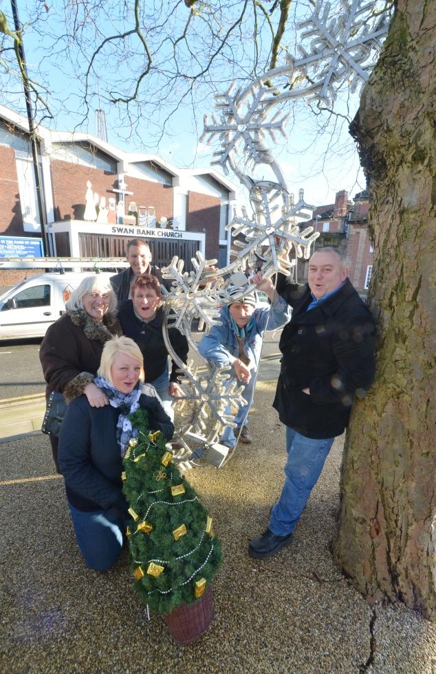 Burslem's Christmas lights campaigners celebrate their success.
