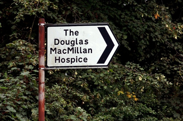 Sign pointing motorists to the Dougie Mac hospice.