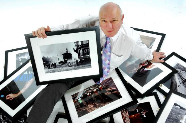 Sentinel photographer Steve Bould with a selection of images taken by Sentinel photographers over the years which were displayed at the Potteries Museum and Art Gallery in an exhibition entitled 'Dear Happy Ghosts