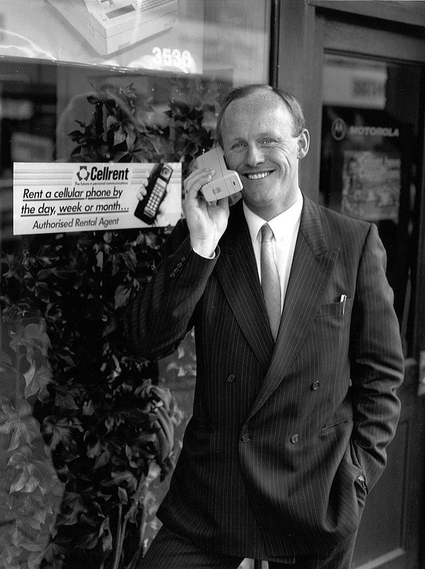 John Caudwell, who went on to become a mobile phone billionaire, with one of the early Motorola devices.