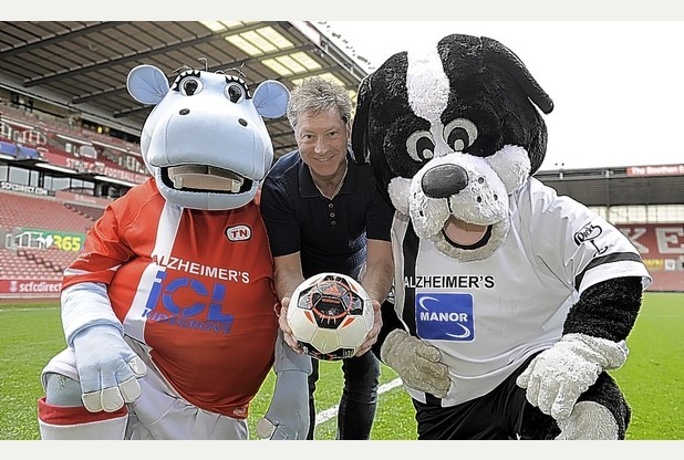 Former Vale striker Tony Naylor with Stoke and Vale mascots Pottermus and Boomer.